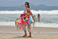Picture of Woman selling bikinis on Ipanema beach - Brazil