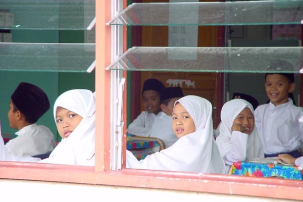 Send picture of Students attending lessons in a Kampung Ayer school from Brunei as a free postcard
