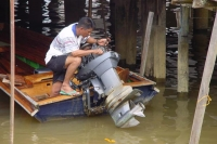 Picture of Man fixing his boat in Kampung Ayer - Brunei