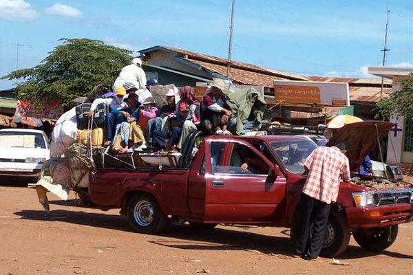Send picture of Overloaded car from Cambodia as a free postcard