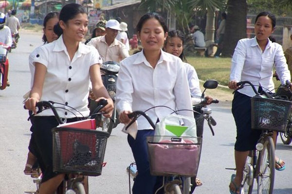Send picture of Cycling home from school (Battambang) from Cambodia as a free postcard