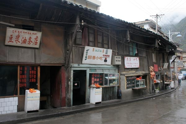 Send picture of Shops in Kangding from China as a free postcard