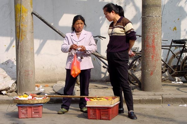 Send picture of Fruit vendor in Shanghai from China as a free postcard