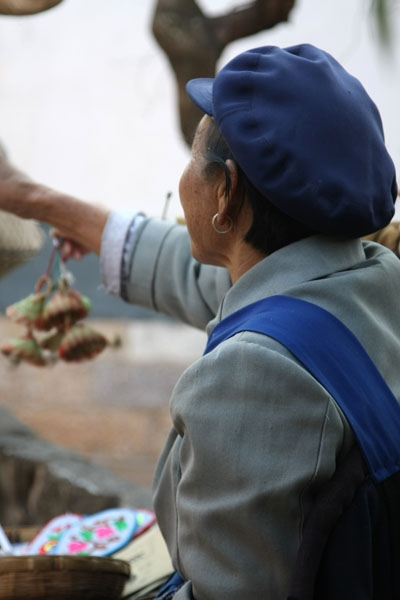 Send picture of Elderly woman from Yunnan province wearing a Mao cap from China as a free postcard