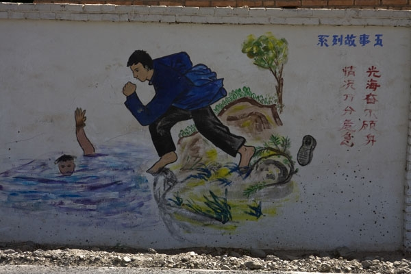 Send picture of Moral mural on a wall in Turpan from China as a free postcard