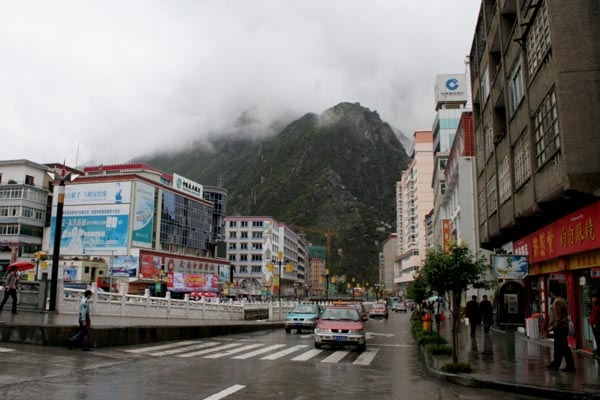 Send picture of Street in Kangding from China as a free postcard