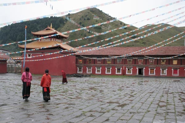 Send picture of The courtyard of Tagong lamasery from China as a free postcard