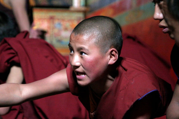 Send picture of Debating monk in Tibet from China as a free postcard