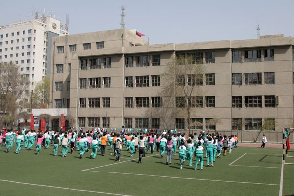 Send picture of Students gathering on the football field of a school in Xining from China as a free postcard