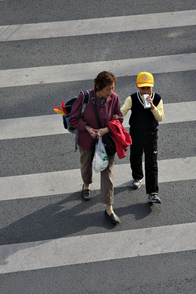 Send picture of Woman and boy in Peking from China as a free postcard