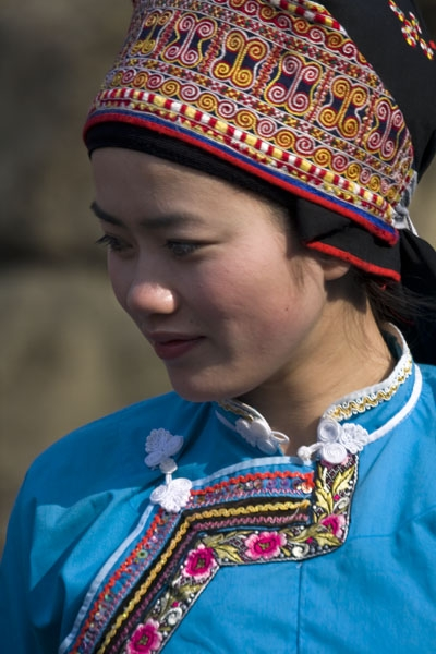 Send picture of Woman in traditional dress in Shi Long Zhai from China as a free postcard
