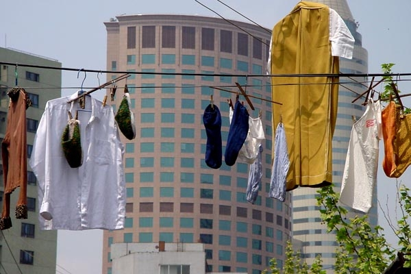 Send picture of Laundry and modern buildings in Shanghai from China as a free postcard