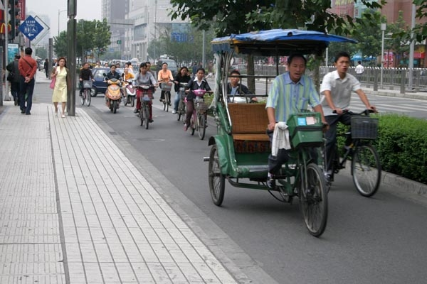 Send picture of Cycle taxi in Chengdu from China as a free postcard