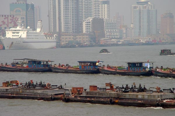 Send picture of Boats in front of modern Shanghai buildings from China as a free postcard