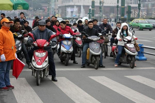 Stuur foto van Electric scooters in Chengdu van China als een gratis kaart