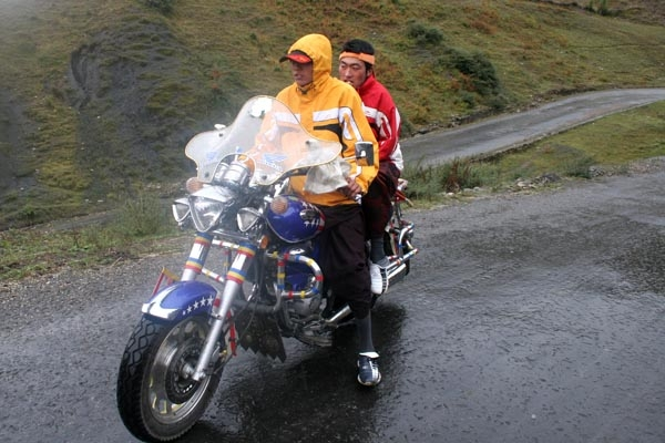  Tibetan men on motorcycle near Tagong
