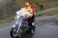 Photo de Tibetan men on motorcycle near Tagong - China