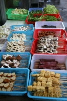 Foto di Various Chinese food in a food stand - China
