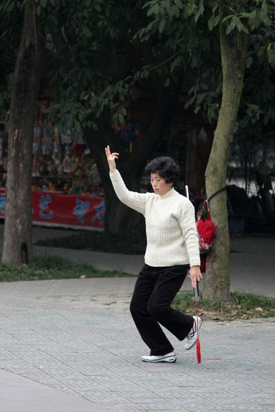 Send picture of Woman practicing with a sword in Chengdu from China as a free postcard