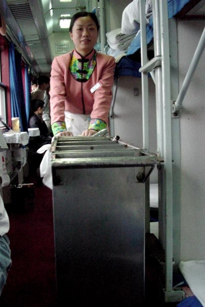 Send picture of Woman serving food in a Chinese train from China as a free postcard