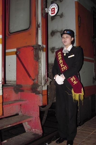 Send picture of Chinese ticket inspector from China as a free postcard