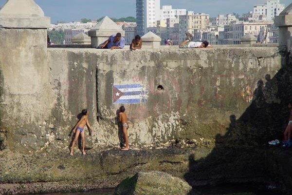 Boys playing at the harbor in Havana