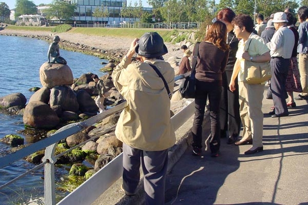Send picture of The very, very Little Mermaid, and tourists from Denmark as a free postcard
