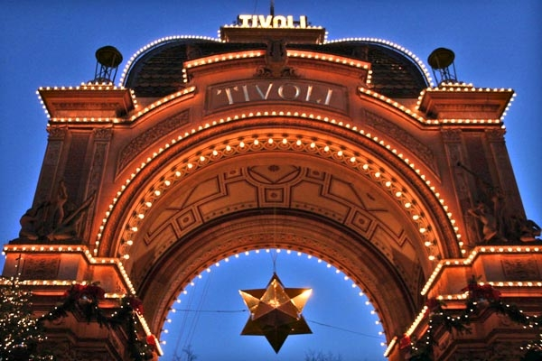 Send picture of The entrance of the Tivoli Gardens in Copenhagen from Denmark as a free postcard
