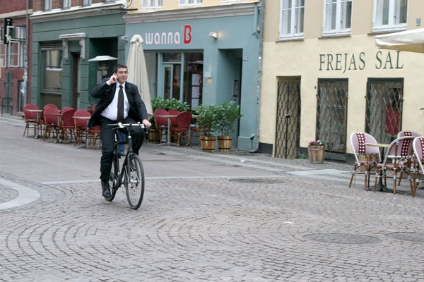 Send picture of Man cycling in the center of Copenhagen from Denmark as a free postcard