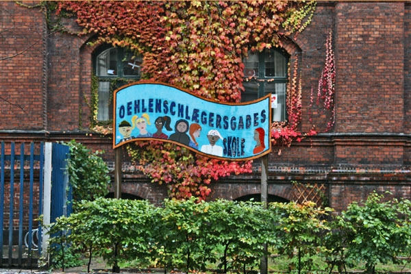 Send picture of Sign at the entrance of Oehlenschlaegersgade school from Denmark as a free postcard