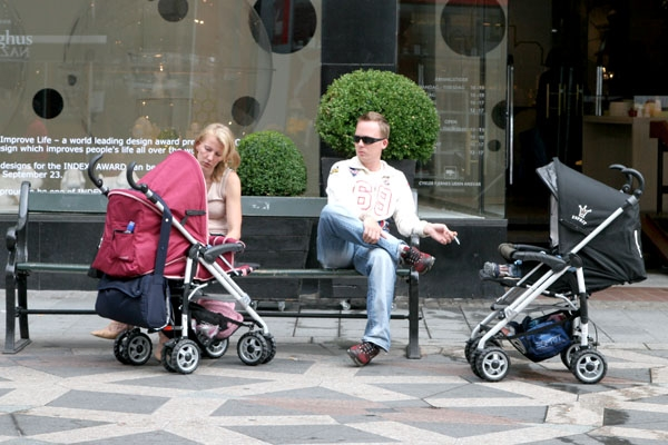 Send picture of Parents and babies enjoying the sun in Copenhagen from Denmark as a free postcard