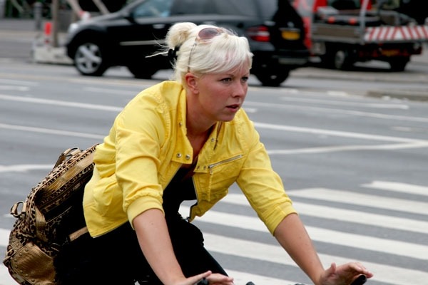 Send picture of Woman cycling in Copenhagen from Denmark as a free postcard