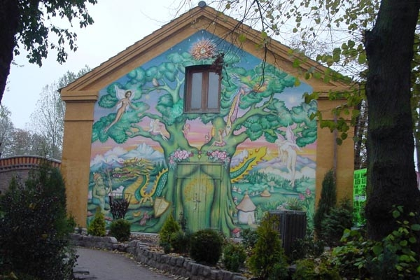 Send picture of Colorful house facade in Christiania, Copenhagen from Denmark as a free postcard