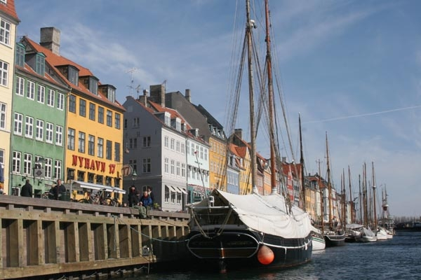 Send picture of Boats in Nyhavn from Denmark as a free postcard