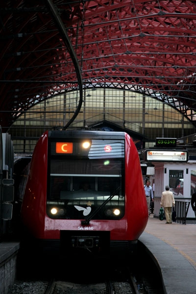 Send picture of Train at Copenhagen Central Station from Denmark as a free postcard