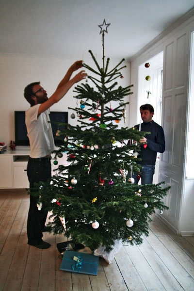 Send picture of Decorating the Christmas tree in Copenhagen from Denmark as a free postcard