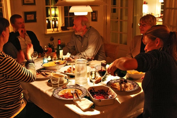 Send picture of A Danish family lingering over Christmas dinner in Ørslev from Denmark as a free postcard