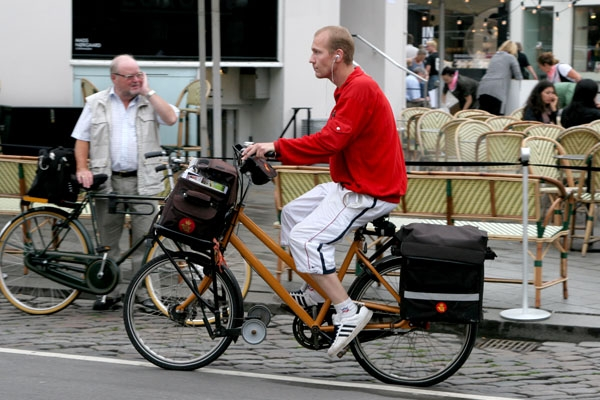 Send picture of A Copenhagen postman from Denmark as a free postcard