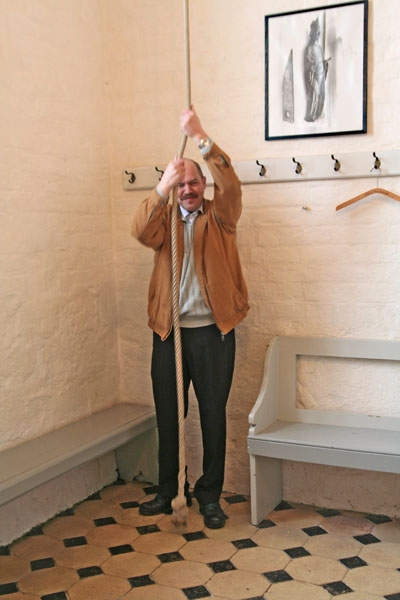 Send picture of Church bell ringer in Ørslev Kirke from Denmark as a free postcard