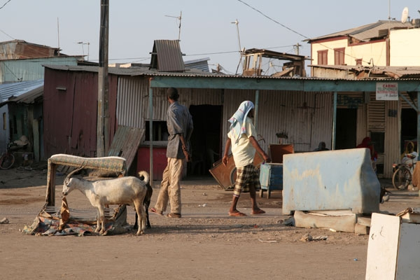 Send picture of Getting rid of old furniture in a Djibouti street from Djibouti as a free postcard