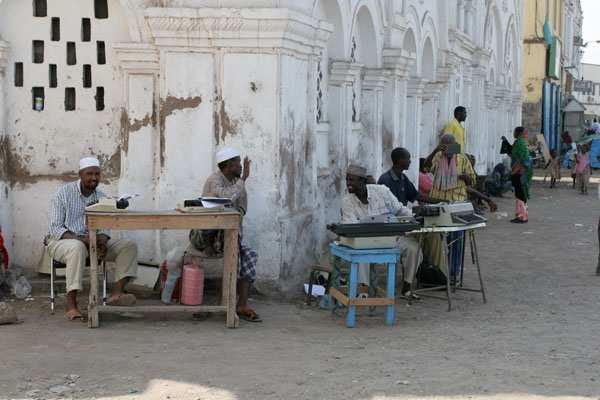 Send picture of Typists at the typist corner in Djibouti from Djibouti as a free postcard