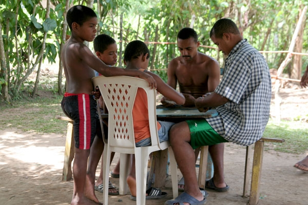 Send picture of People playing a board game in Limón from Dominican Republic as a free postcard