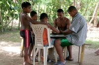 Photo de People playing a board game in Limón - Dominican Republic