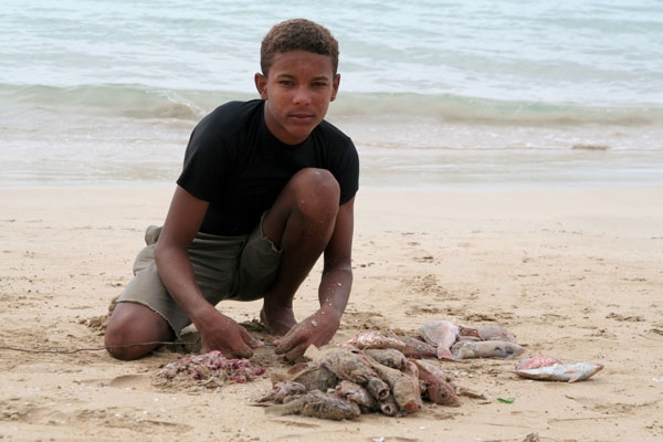 Send picture of Young fisherman in Las Terrenas from Dominican Republic as a free postcard