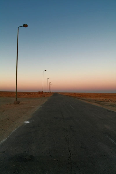 Send picture of Desert road in western Egypt from Egypt as a free postcard