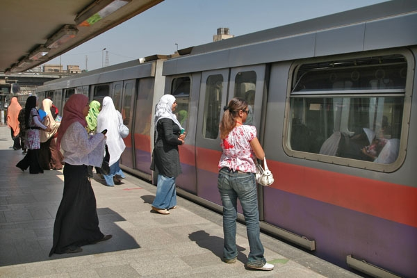 Send picture of The two front cars of a metro train are always reserved for women from Egypt as a free postcard