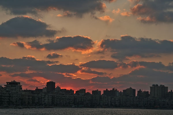 Send picture of Sunset over Alexandria from Egypt as a free postcard