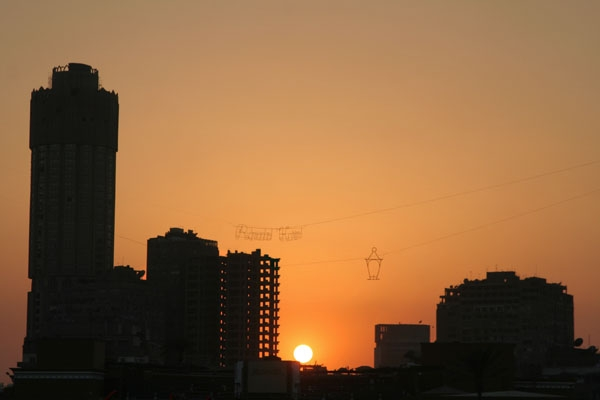 Send picture of Sunset and Ramadan Kareem sign in Cairo  from Egypt as a free postcard