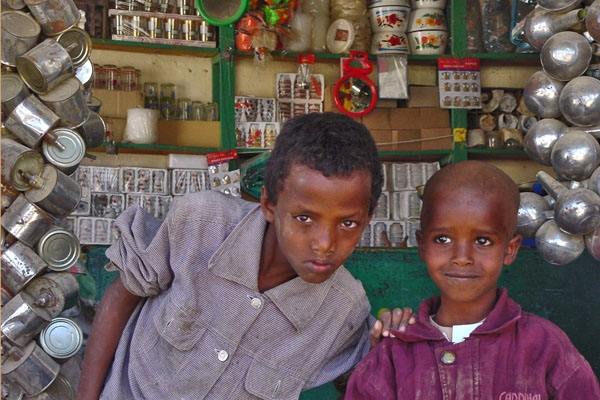 Send picture of Boys working in a shop in Keren from Eritrea as a free postcard