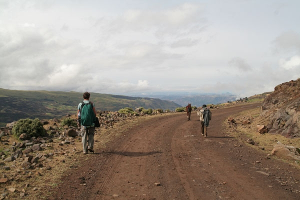 Send picture of A scout, a tourist and a horse with no name on a mountain road from Ethiopia as a free postcard